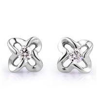 Flower Shape Solitaire Diamond Earring Studs In Side bezel set Round Brilliant Diamonds.