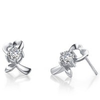 Heart Shape Solitaire Diamond Earring Studs In 4 Prong set Round Brilliant Diamonds.